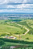 Top view of a country road and the city in the background Stock Photo