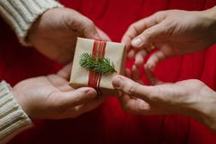 Top view of a couple exchanging Christmas presents stock photos