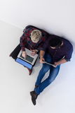 Top view of  couple working on laptop computer at startup office Stock Photography