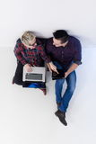 Top view of  couple working on laptop computer at startup office Stock Images