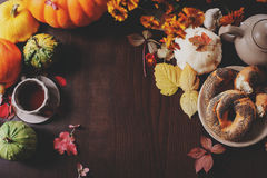 Top view of cozy autumn breakfast at country house with tea, bagel and seasonal decorations Stock Photos