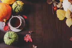 Top view of cozy autumn breakfast at country house with tea, bagel and seasonal decorations Stock Photography