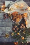 Top view of cozy Christmas and winter setting with homemade cookies, coffee, nuts, weekly planner and New Year decorations Stock Photos