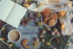 Top view of cozy Christmas and winter setting with homemade cookies, coffee, nuts, weekly planner and New Year decorations Royalty Free Stock Photo