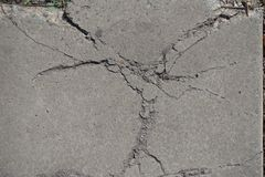 Top view of cracked concrete surface. Top view of cracked grey concrete surface Stock Photo