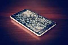 Top view cracked glass screen black and white,. Close up. Phone repair concept. Old broken phone with black screen. The display cracked in the form of a web royalty free stock photography