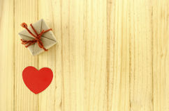 top view of craft gift box with heart on wood background concept stock images