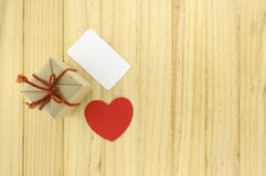 Top view of craft gift box with heart on wood background concept Royalty Free Stock Image