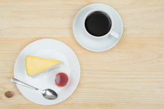 Top view of crape cake with strawberry sauce and cup of coffee. On wooden table Stock Images