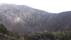 Crater of the Irazu volcano in Costa Rica with mist. Top view of Crater of the Irazu volcano in Costa Rica stock footage