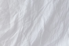 Top view of creased bedding sheets. Texture useful as displacement map Stock Image