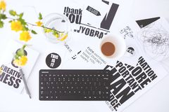 Top view of creative workspace with keyboard and coffee royalty free stock images