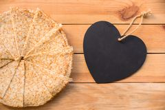 Top view of crepes french pancakes, blank heart with copy space, wood background. Top view of crepes french pancakes, blank heart with copy space, rustic wood stock photo