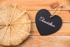 Top view of crepes french pancakes, word chandeleur meaning candlemas written on a heart, rustic wood background. Top view of crepes french pancakes, word Stock Images