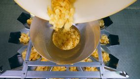 Top view of crisps going through the distribution machine. HD stock video footage