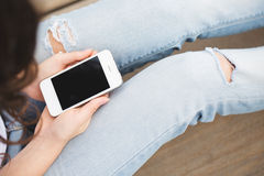 Top view cropped shot of a woman holding phone in her hands. Stock Photography