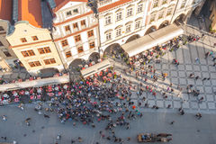 Top view of a crowd of people standing on the Old Town Square.