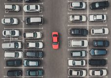 Top view of the crowded Parking lot with quadcopter or drone. Original bright automobile among the grey of mediocre cars. Parking. Space search, No parking royalty free stock images