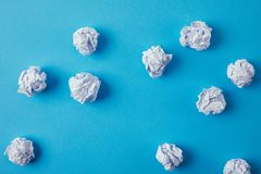 Top view of crumpled papers. On blue surface royalty free stock images