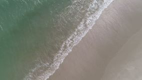 Top view of crushing waves on the beach.  stock footage