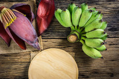 Top view Cultivated banana and banana blossom on the table. Stock Photo