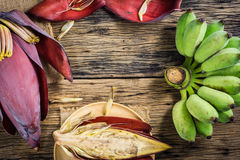Top view Cultivated banana and banana blossom on the table. Royalty Free Stock Images