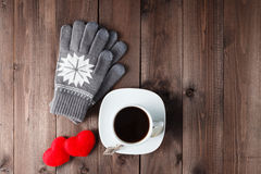 Top view of Cup of black coffee with  gloves on wooden backgroun Royalty Free Stock Photo