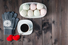 Top view of Cup of black coffee with  gloves on wooden backgroun Stock Image