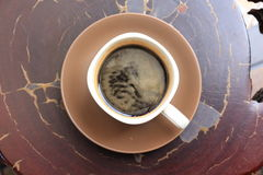 Top View of Cup of Black Coffee on a Wooden Table. Top View of Black Coffee Cup on a Wooden Table Royalty Free Stock Photography