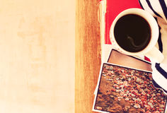 Top view of cup of coffe and stack of photos  filtered image  travel or vacation concept Stock Photos