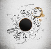 Top view of a cup of coffee and black business icons with question mark on the concrete background. The concept of brainstorm process Royalty Free Stock Photo