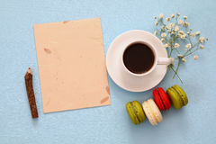 Top view of cup of coffee with colorful macaron or macaroon Royalty Free Stock Images