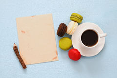 Top view of cup of coffee with colorful macaron or macaroon Royalty Free Stock Photography