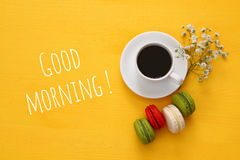 Top view of cup of coffee with colorful macaron Stock Photos