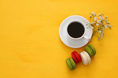 Top view of cup of coffee with colorful macaron or macaroon Stock Photo