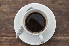 Top view of a cup of coffee. Isolate on white over grunge wood Stock Photos