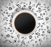 Top view of a cup of coffee and a lot of educational black icons are drawn around it.  Royalty Free Stock Photos