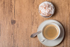 Top view on cup of coffee and muffin Royalty Free Stock Image