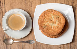 Top view on cup of coffee and plate with cookies Stock Images