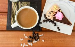 Top view cup of coffee with slice of chocolate cake Royalty Free Stock Photos