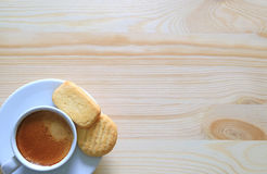Top View of a Cup of coffee with Two Butter Cookies on the Wooden Table with free space for text. Top View of a Cup of coffee with Two Butter Cookies on the Royalty Free Stock Photo