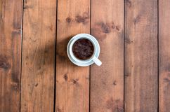 Top view cup of coffee on wooden background.  Royalty Free Stock Photos