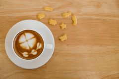 Top view, Cup of coffee on wooden table royalty free stock image