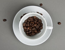 Top view of the cup filled up with coffee bean. Stock Photos