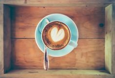 Top view cup of hot coffee art on saucer with spoon. Stock Photos