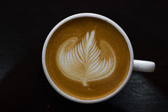 Top view cup of hot latte art coffee. Royalty Free Stock Photos