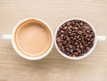 Top view of cup of latte and cup of coffee bean Royalty Free Stock Photo