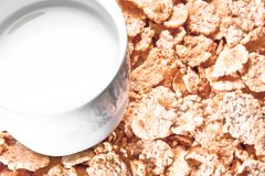 Top of view of cup of milk on corn flakes Stock Images