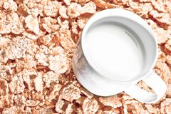 Top of view of cup of milk on corn flakes, diet concept Royalty Free Stock Photos