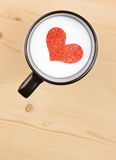 Top of view of cup of milk with decorative heart on wood table, concept of valentine day Stock Photography